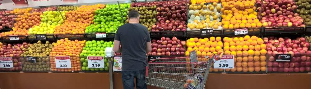 Man selecting fruit